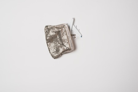 Passenger plane in wallet on a light background. Low-cost concept.