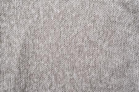 Textura de un suéter de punto de lana gris. De cerca. Sin costura Foto de archivo