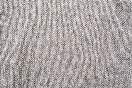 Texture of a gray wool knitted sweater. Close-up. Seamless