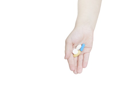 Tablets on a children's palm. Isolate on white background.