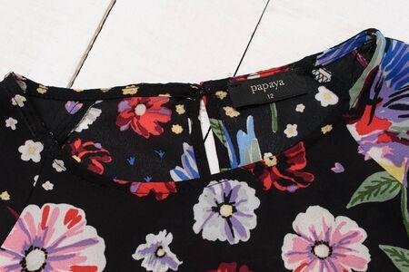 KHARKOV, UKRAINE - APRIL 27, 2019: Black Papaya tag on black flowering blouse. Close-up