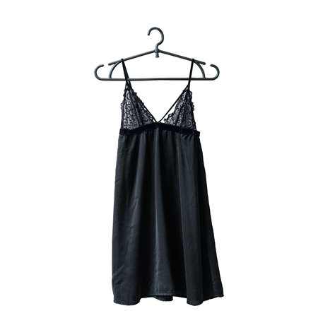 Black lace nightie on the hanger. White background. Isolate Stock Photo