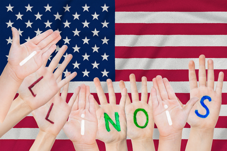 Inscription Illinoise on the children's hands against the background of a waving flag of the USA Standard-Bild - 123933236