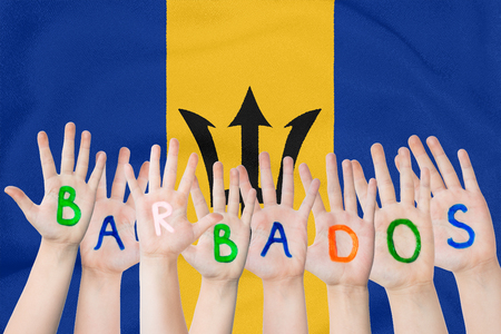 Inscription Barbados on the children's hands against the background of a waving flag of the Barbados Standard-Bild - 123933378
