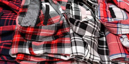 Many plaid shirts close up. Clothing concept. Side view