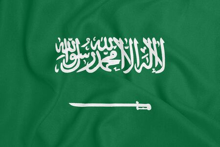 Flag of Saudi Arabia on textured fabric. Patriotic symbol