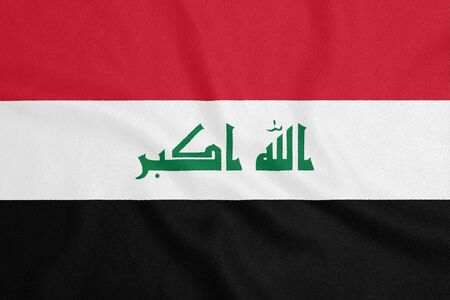 Flag of Iraq on textured fabric. Patriotic symbol Stock fotó