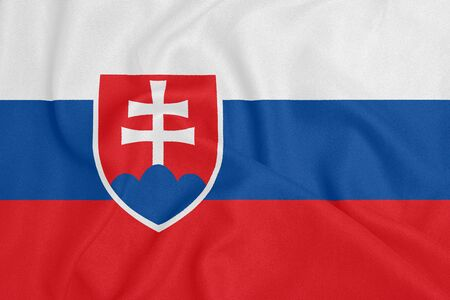 Flag of Slovakia on textured fabric. Patriotic symbol