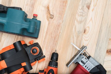 Set Of Handheld Woodworking Power Tools For Woodworking On Light