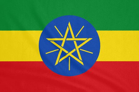 Flag of Ethiopia on textured fabric. Patriotic symbol