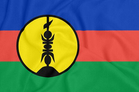 Flag of New Caledonia on textured fabric. Patriotic symbol