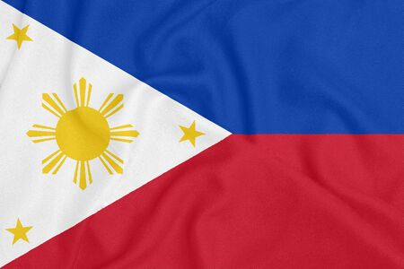 Flag of Philippines on textured fabric. Patriotic symbol Reklamní fotografie