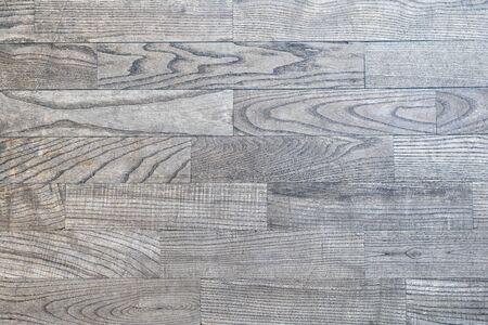 Graues Holzparkett mit schöner Textur.