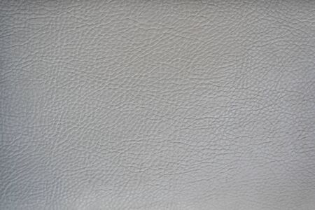 Light gray leather smooth surface. Backgrounds and textures.