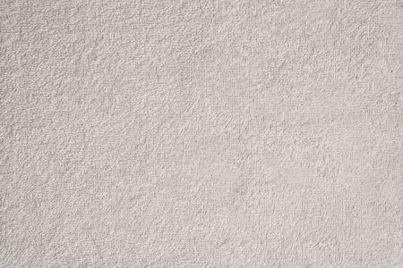 Texture liscia e senza cuciture di un asciugamano in spugna. Colore bianco