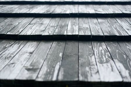 Old roof made of gray wooden planks. Close up.