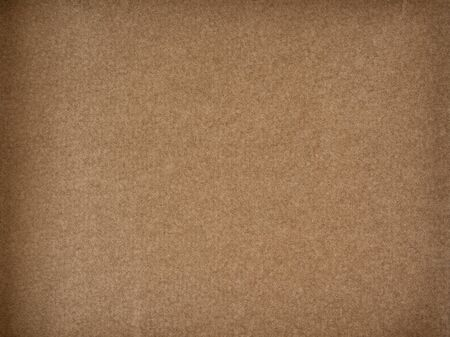 Brown woolen texture fabric. Cashmere. Solid seamless background.