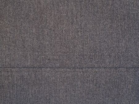 Gray woolen texture fabric. Cashmere. Solid background.