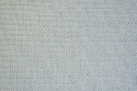 Pale blue textured fabric. Small rectangles. Solid seamless background.