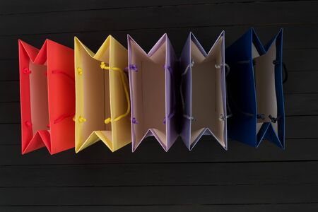 Five empty multi-colored shopping bags. Top view. No shopping