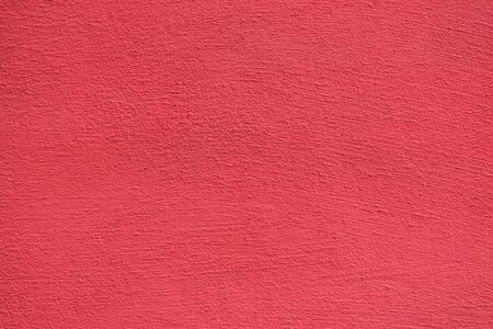 Bright rough plastered surface. Living coral colored. Backgrounds and textures.