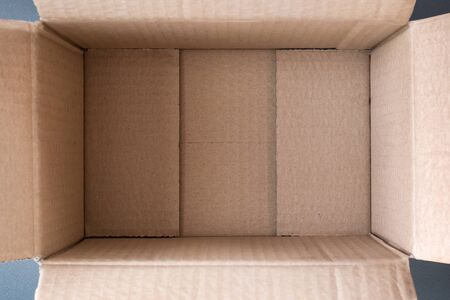Empty open cardboard box, inside view. Close up