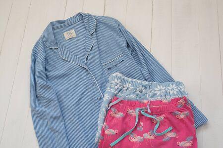 KHARKIV, UKRAINE - September 19, 2019: Blue striped pajamas and two pajama pants. Clothing concept