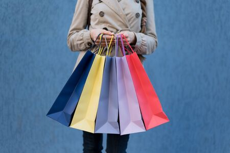 Five colored bags for shopping in a female hands. Close-up. Shopping 写真素材