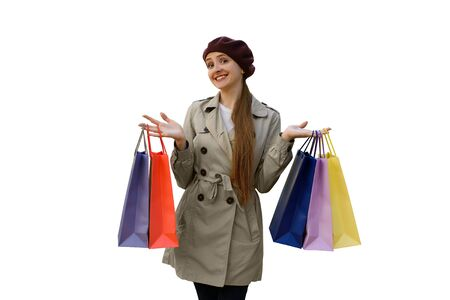 Happy young woman shopaholic with colorful bags. Isolated, white background