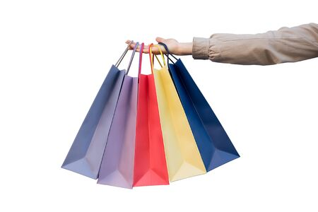 Five colored bags for shopping in a female hand. Close-up, isolate. Shopping