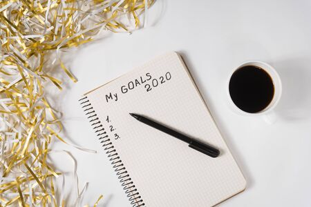 Phrase My Goals 2020 in a notebook, pen. Mug of coffee and tinsel. Top view Stok Fotoğraf