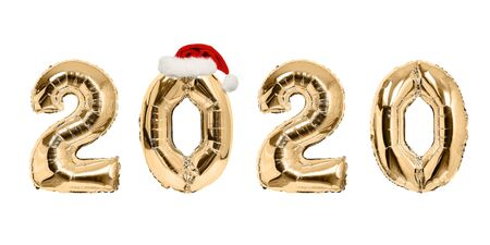 Number 2020 of golden balloons with red Santa hat. White background. New Year concept
