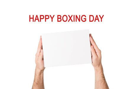 Happy boxing day. Box with white empty in male hands. White background Stok Fotoğraf