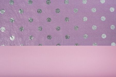 Textural background lilac polka dots and pink. Layout for design.