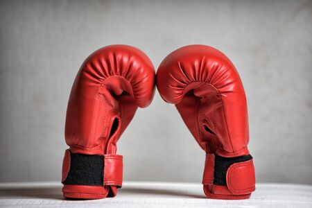 Pair of red boxing gloves on a white background. Close-up Stock Photo