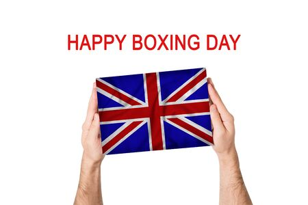 Happy boxing day. Box with Great Britain flag in male hands. White background