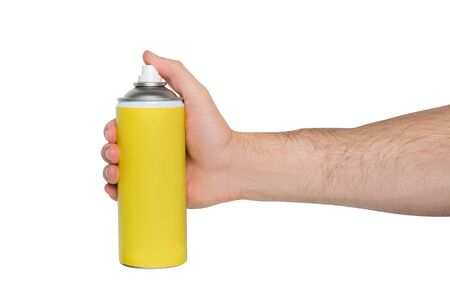 Yellow spray can for spraying in a male hand. No inscriptions. White background