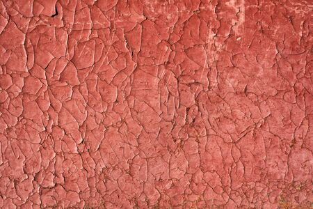 Cracked red paint with rust. Seamless old texture background