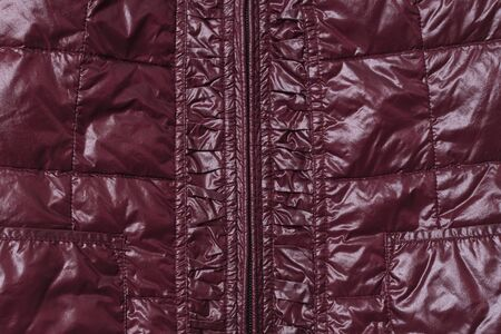 Part of burgundy womens leather jacket with zipper in middle. Top view. Close-up. Zdjęcie Seryjne