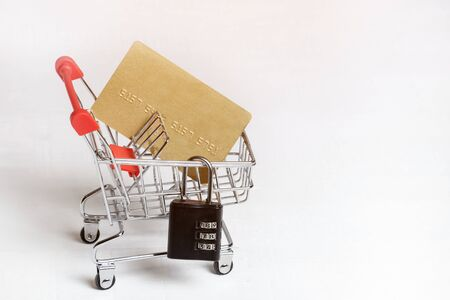 Secure safe shopping. Trolley, credit card and padlock on a white background