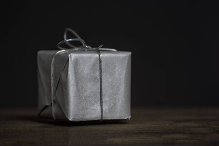 Gift closeup. Present for men on dark background, front view