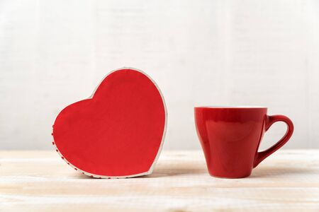 Red cup and heart shaped boxes. Gift, Valentines Day.