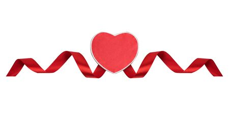 Red heart and satin ribbon on a white background. Symbol of love, Valentines Day. Isolate Imagens