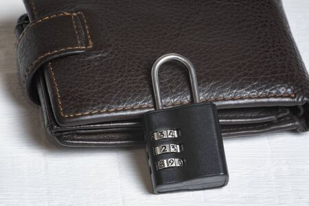 Leather wallet with a combination lock. Safe storage of money. Financial security.