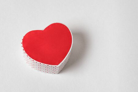 Red heart shaped box on the white background. Copy space. Directly above. Gift for Valentines day