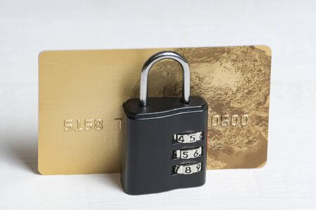 Credit card under lock and key. Financial security. Secure payments. White background, front view.