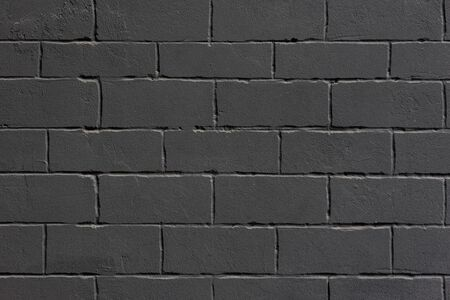 Black grunge loft styled brick wall. Background. Imagens