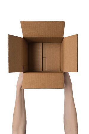 Empty open box in female hands. Service delivery concept. White background. Vertical frame. Imagens