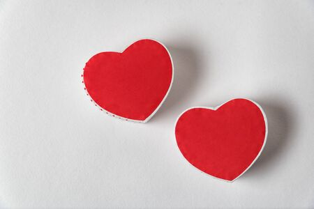 Two red heart shaped box on the white background. Copy space. Directly above. Valentines day Imagens