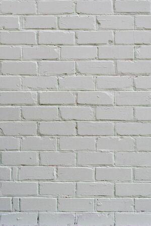 White grunge brick wall. Background, copy space, verrical frame.